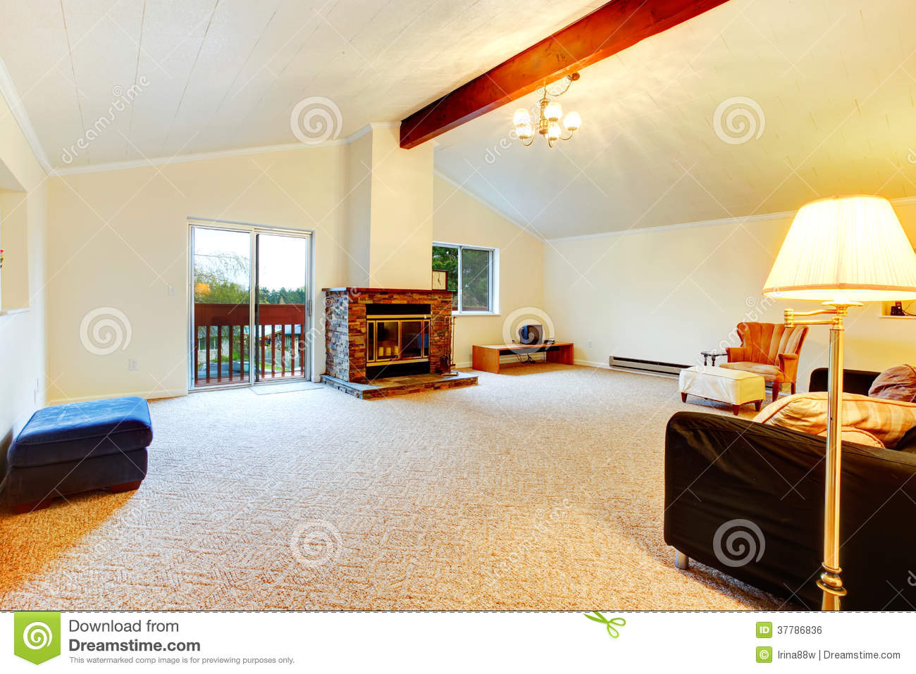 Bright living room with vaulted ceiling and beams, carpet floor, cozy ...