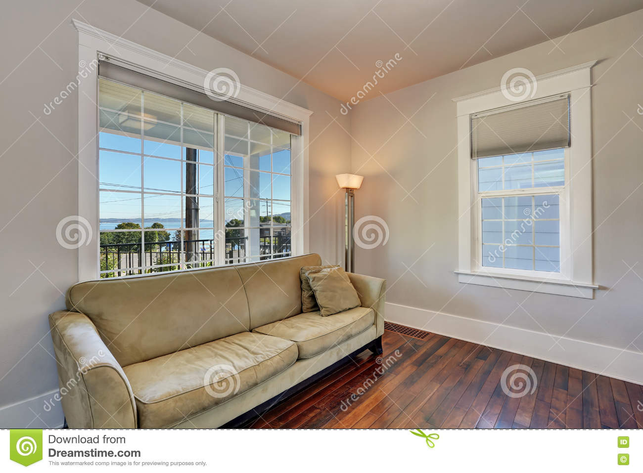 Upstairs living room interior with wood flooring sofa floor lamp and french windows modern house in tacoma northwest usa