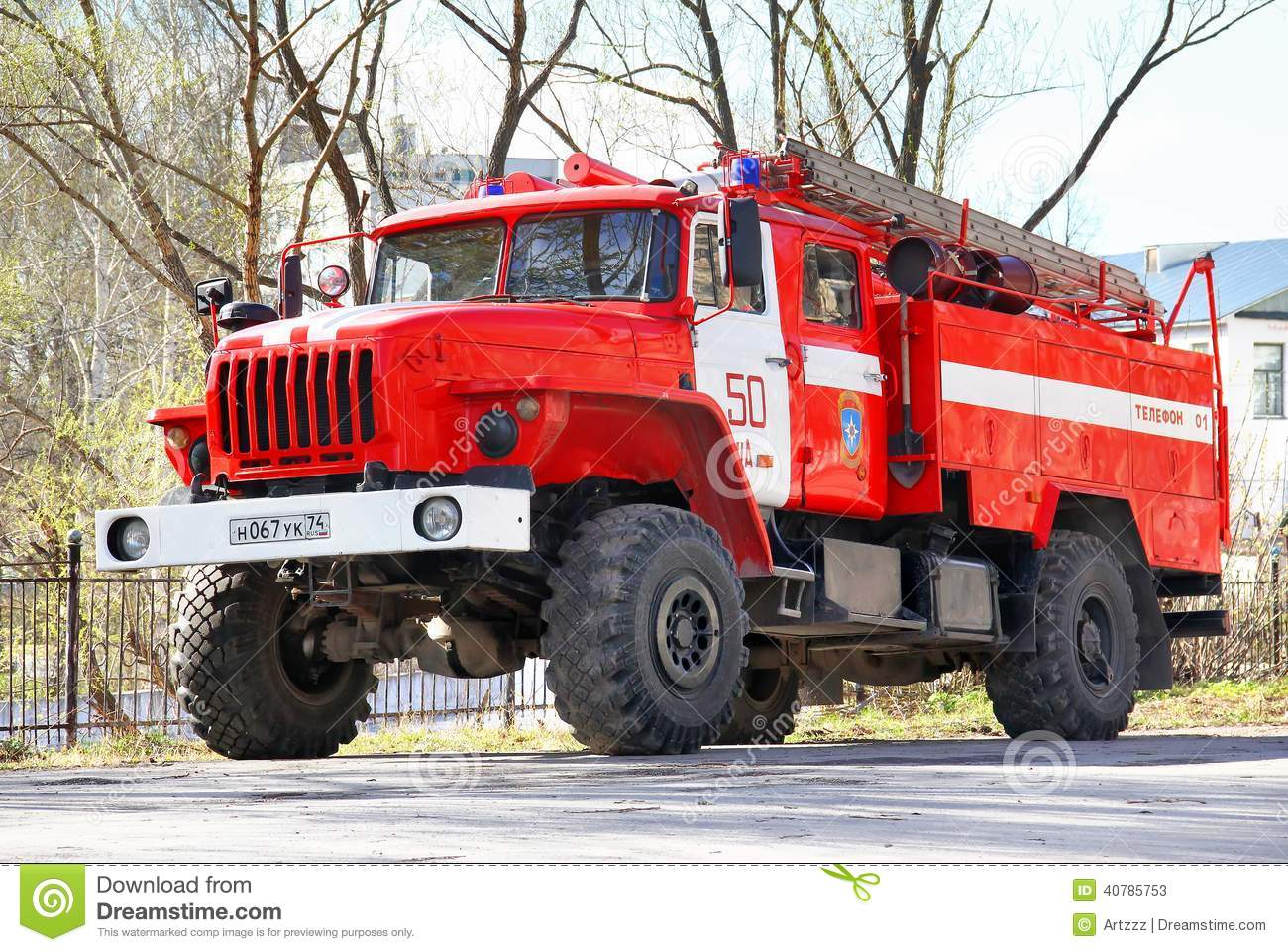 ... , RUSSIA - MAY 4, 2014: Red Ural 43206 firetruck at the city street