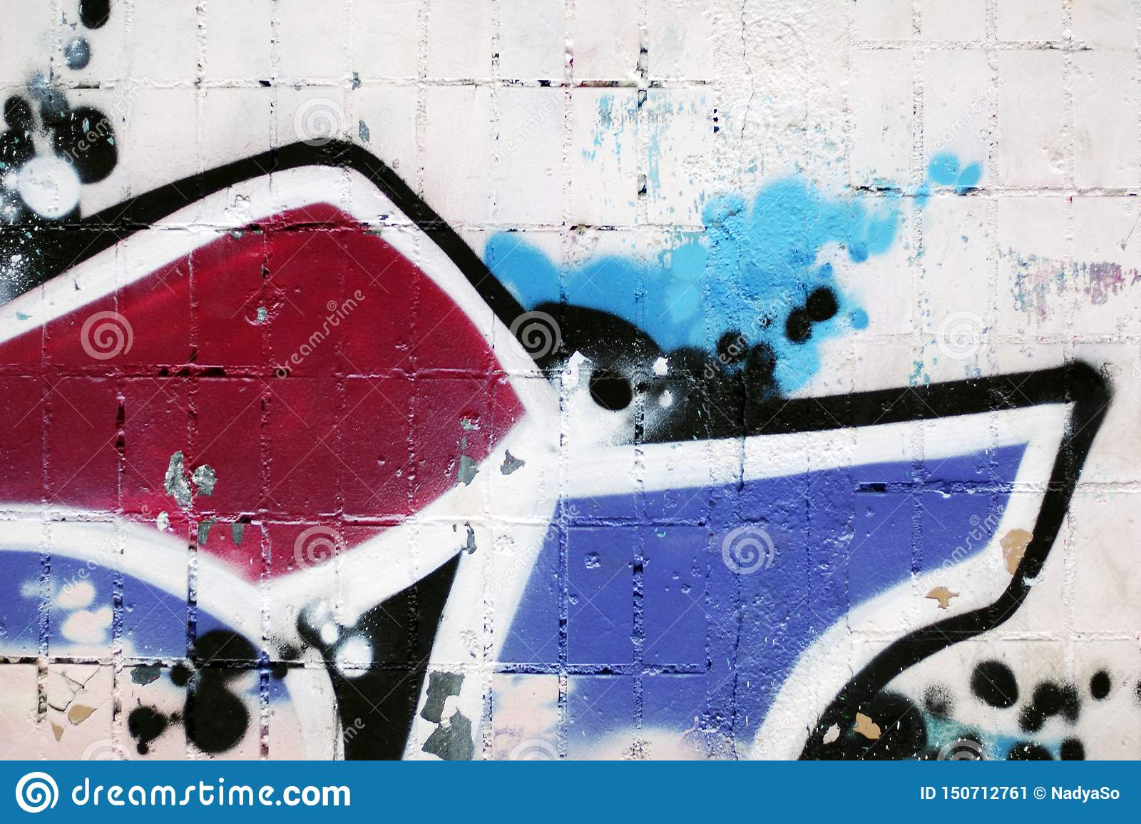 Urban abstract background, shabby wall with fragments of colorful paint