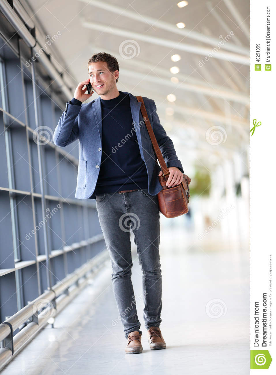 urban-business-man-talking-smart-phone-traveling-walking-full-body-length-inside-airport-casual-young-businessman-wearing-40251359.jpg
