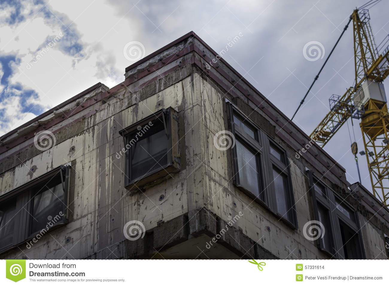 Old Concrete Buildings : Urban concrete building being renovated with crane in the