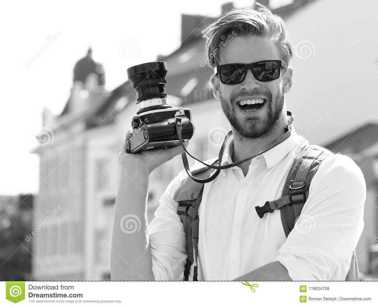 Urban photo and travelling concept. Tourist takes picture of cityscape. Young traveller or photographer