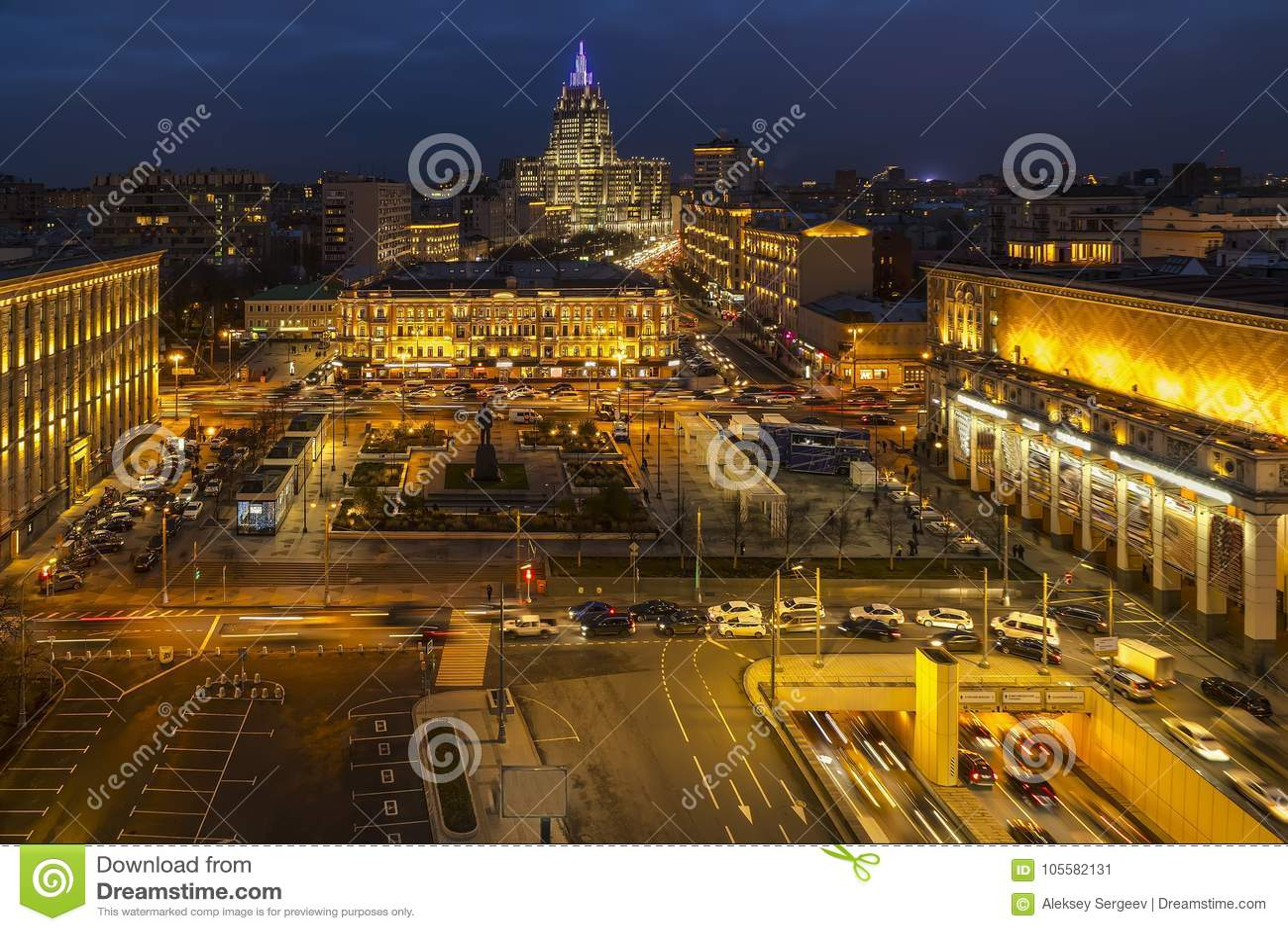 Urban roofs, horizon line and night traffic