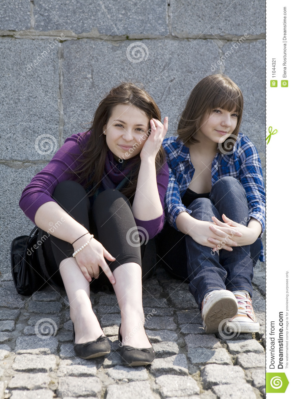 Urban Teen Girls Sitting At Stone Wall Stock Image Image