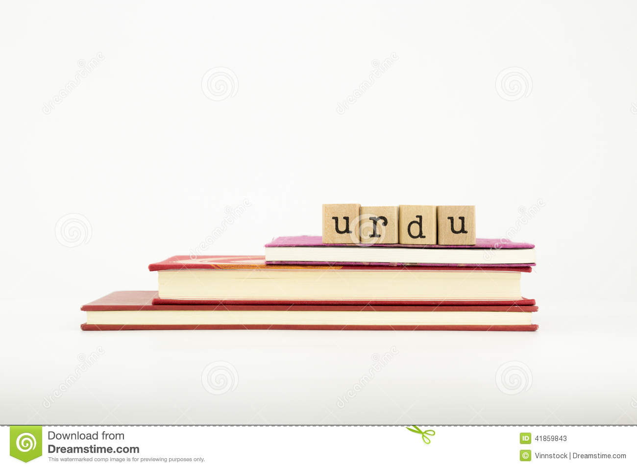 Urdu Language Word On Wood Stamps And Books Stock Image