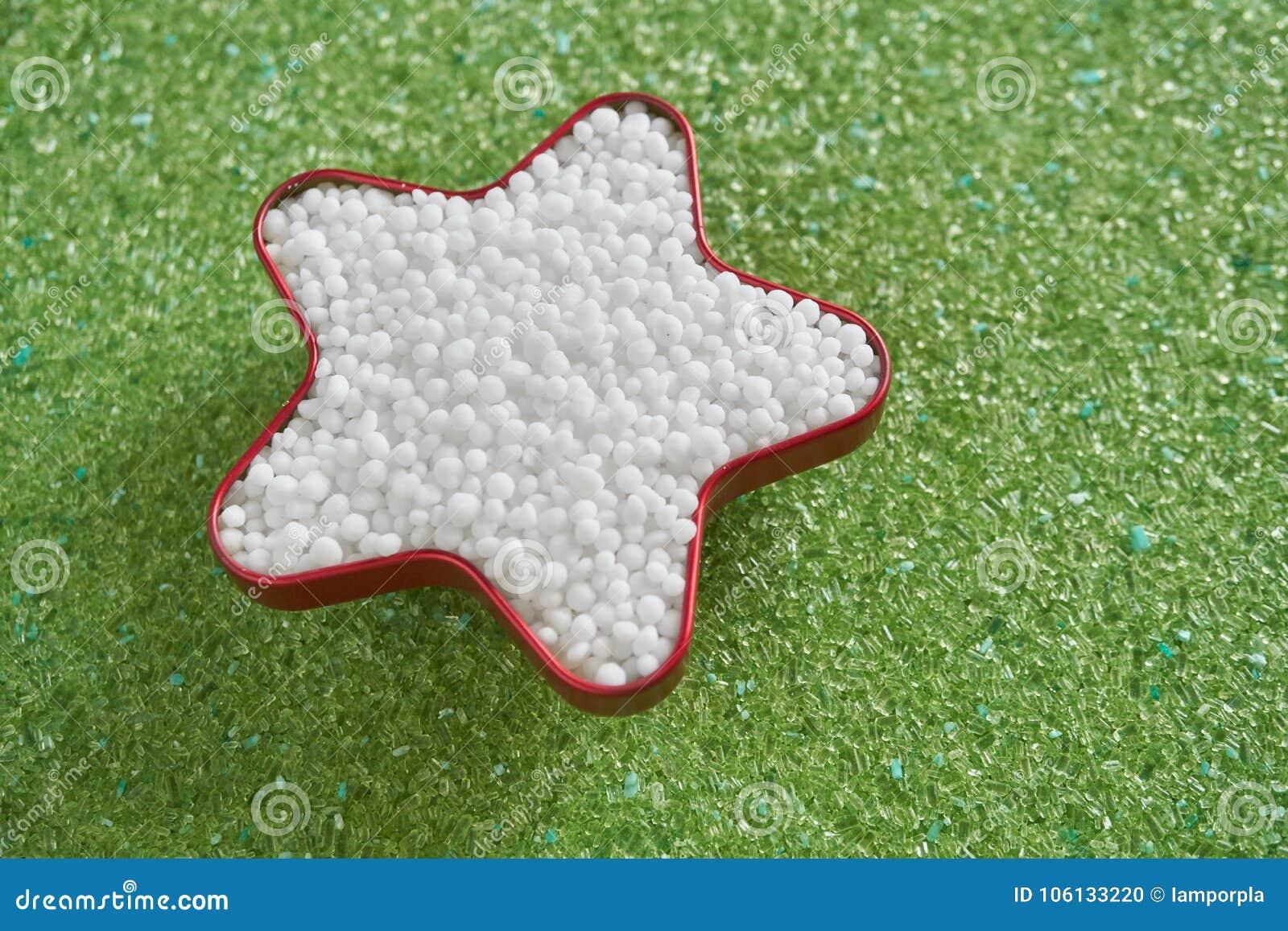 Urea fertilizer in star shape on green magnesium fertilizer