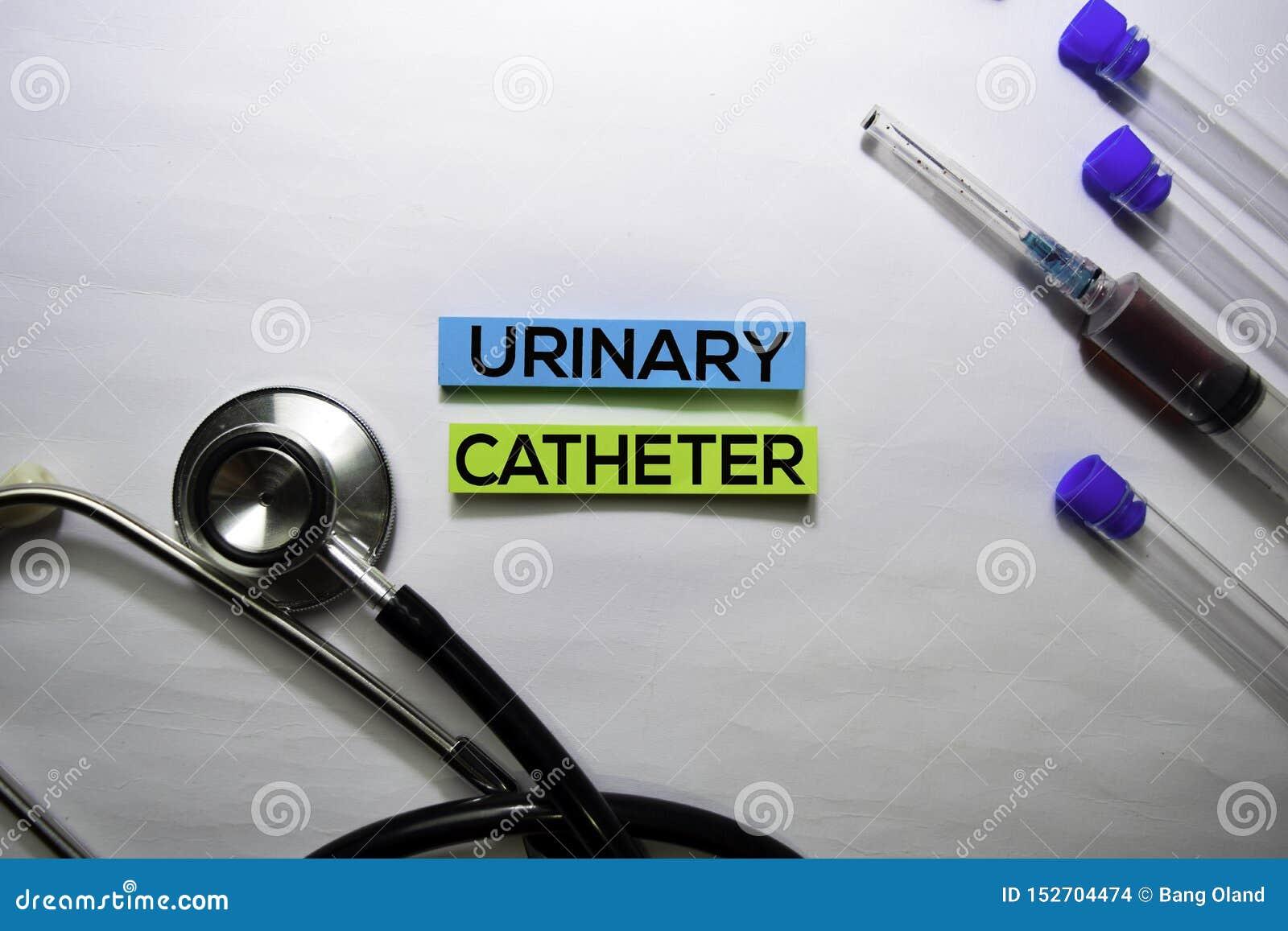 Urinecathetertekst op hoogste die mening op witte achtergrond wordt geïsoleerd Gezondheidszorg/Medisch concept