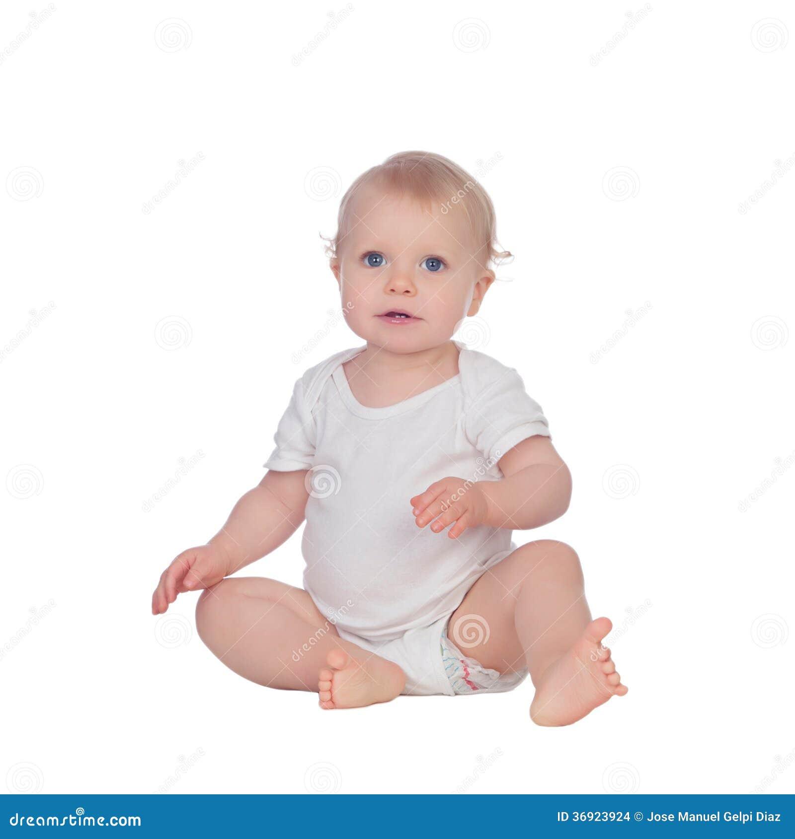 Uroczy blond dziecka obsiadanie na podłoga