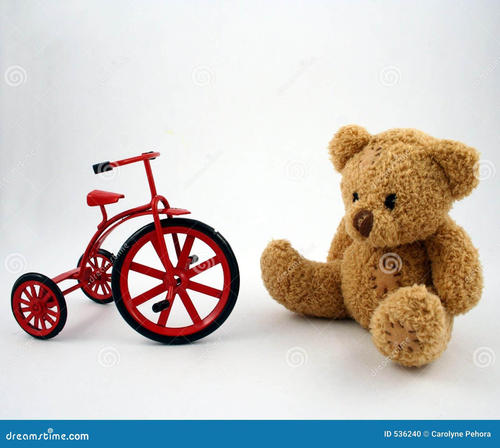 Urso e triciclo da peluche