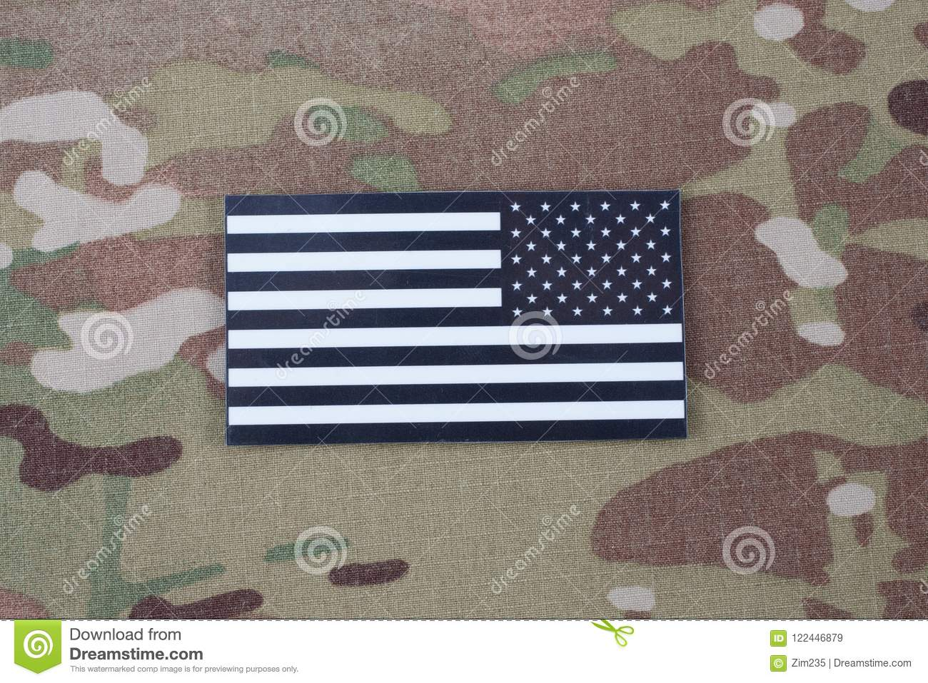 US ARMY flag patch on camouflage uniform