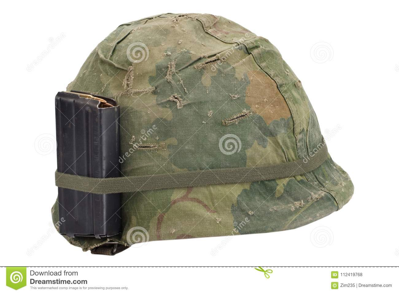 US Army helmet Vietnam war period with camouflage cover, magazine with ammo isolated