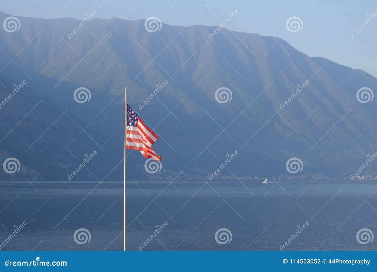 Download US Flag On Lake Como Italy Europe Stock Photo