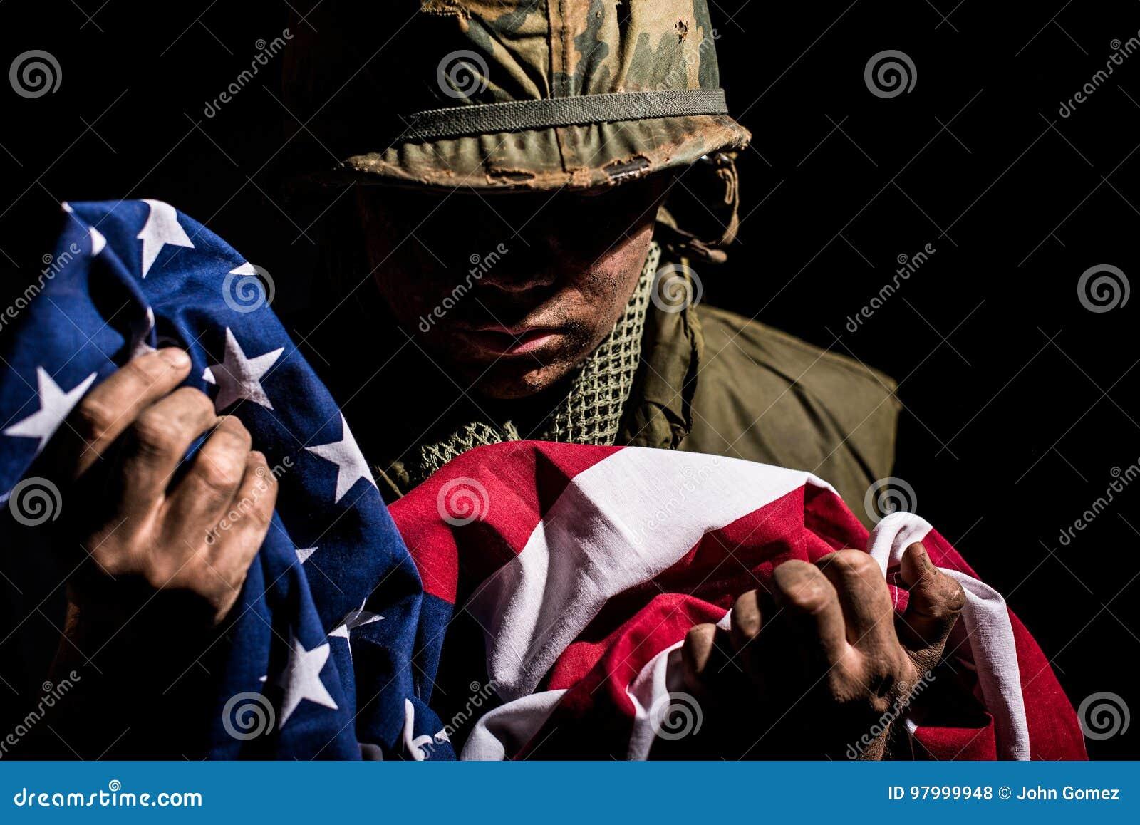 US Marine Vietnam War holding American flag.