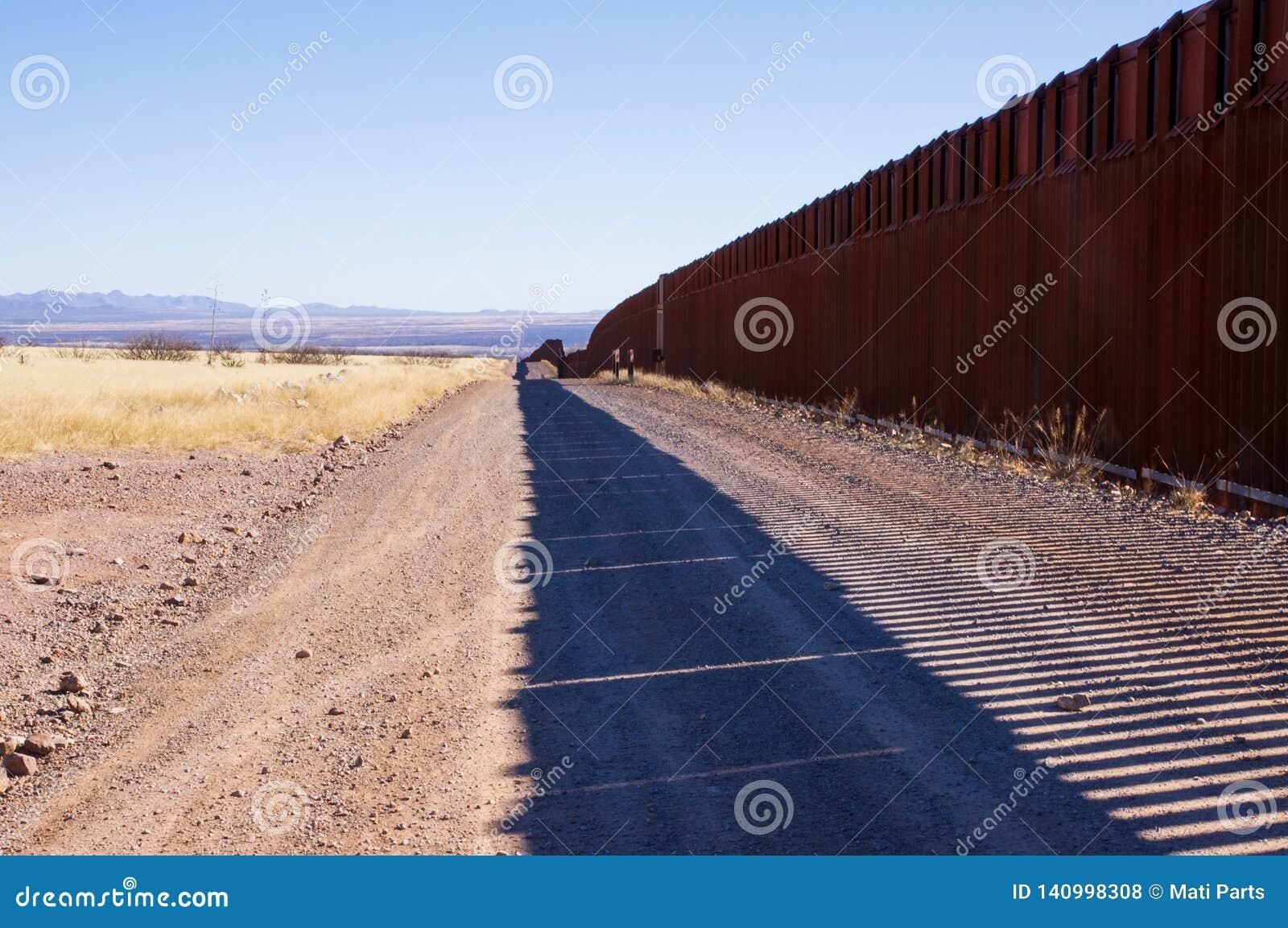The US-Mexico border wall in Arizona desert