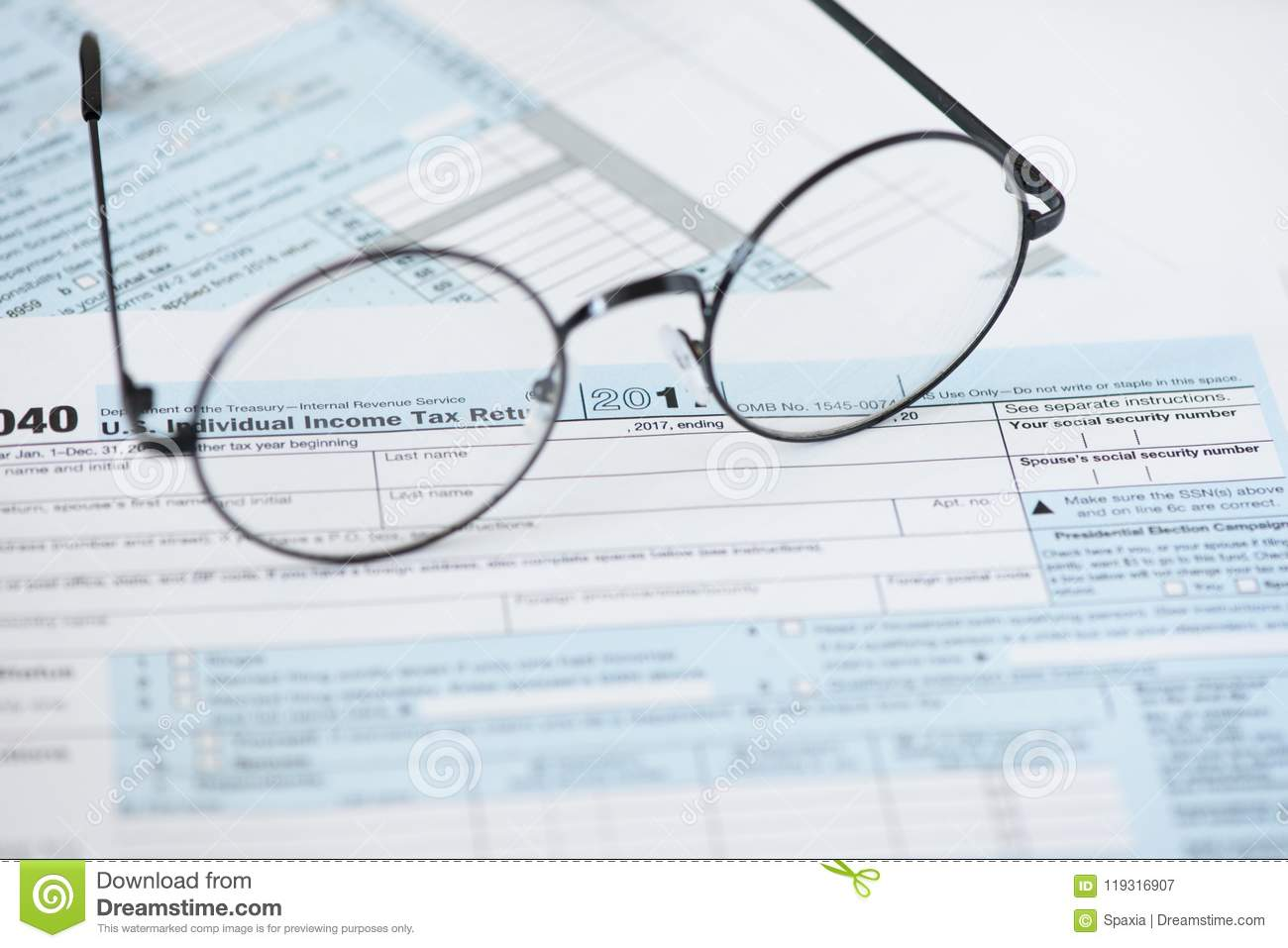US tax form and glasses. Finance concept
