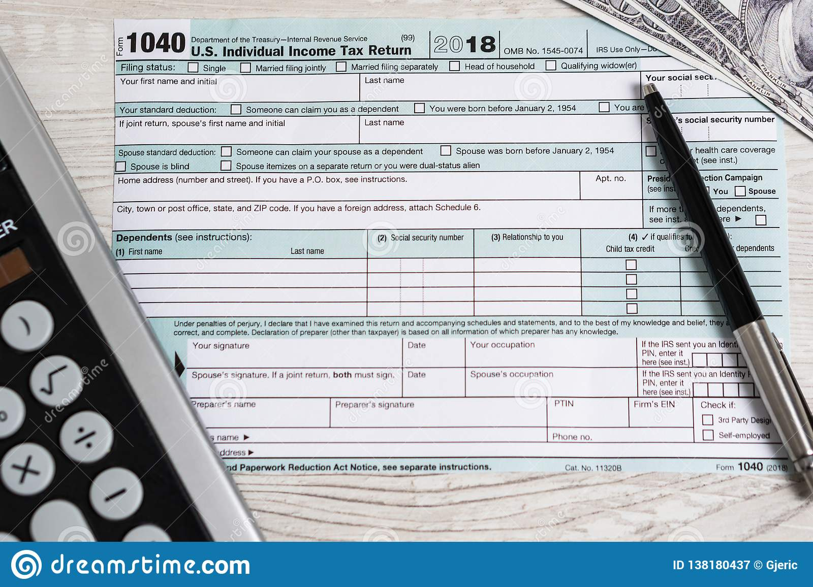 US Tax Form 1040 With Pen, Calculator And Dollar Bills  Tax