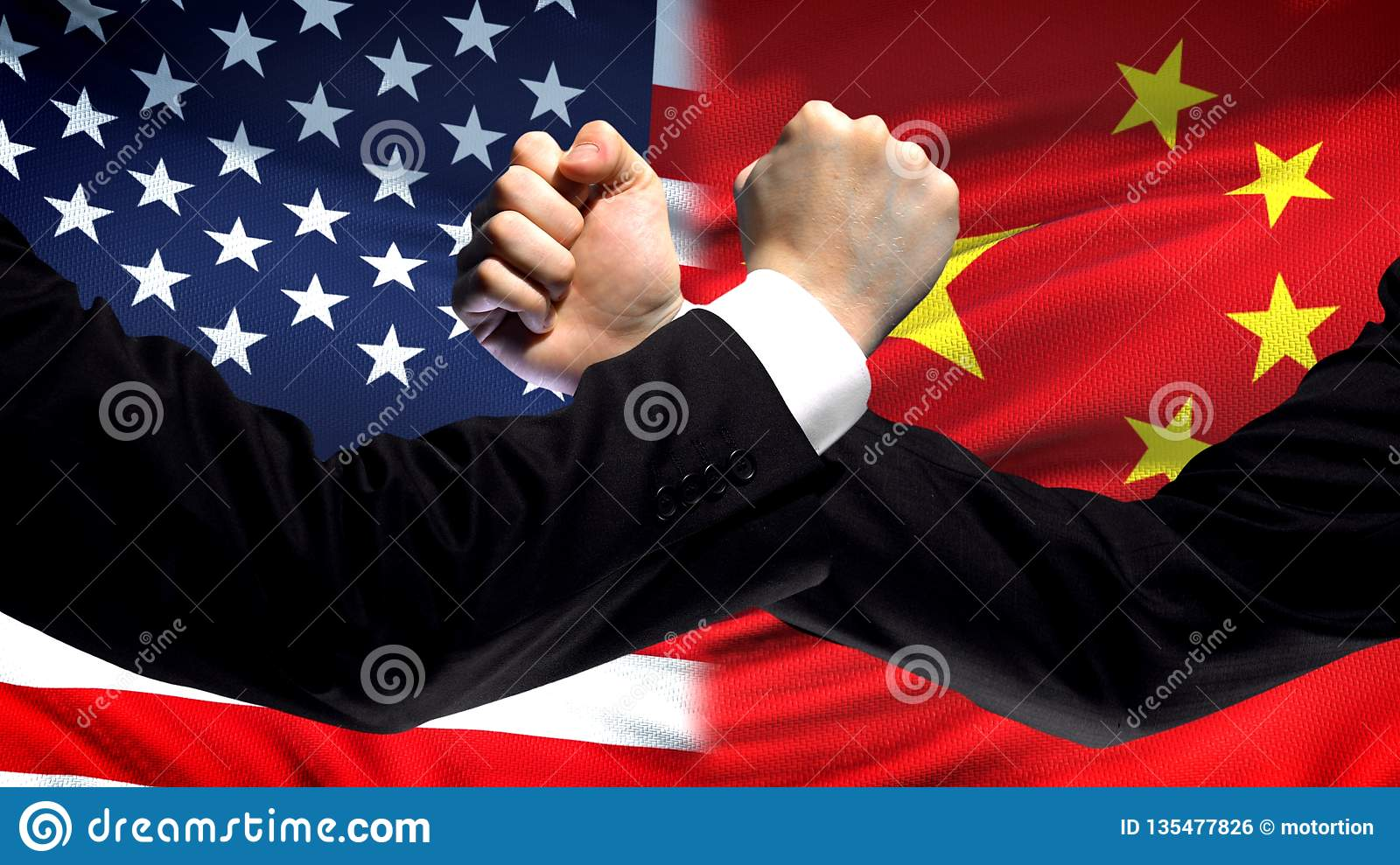 US vs China confrontation, countries disagreement, fists on flag background