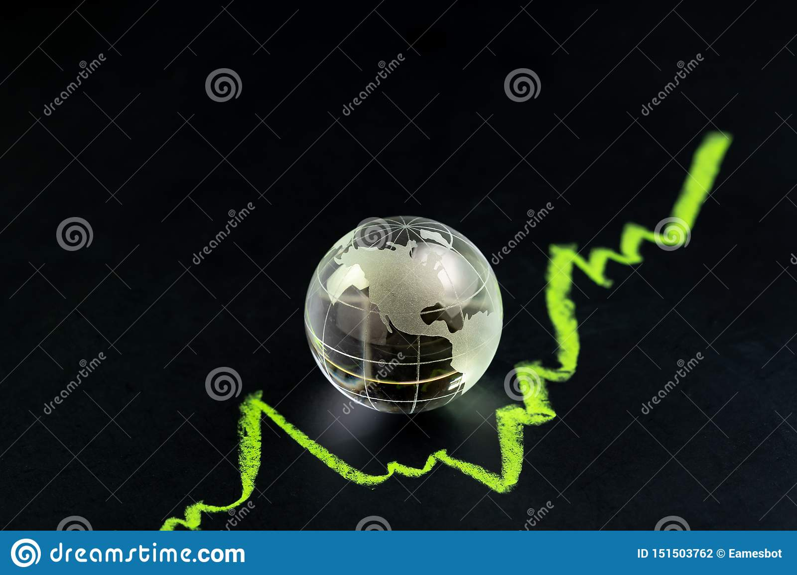 USA or America stock and investment growth, decorate shiny glass globe with United State map on dark black blackboard with chalk