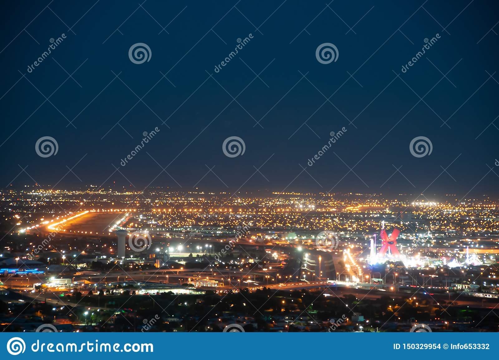 USA-/Mexico gräns, El Paso, TX/Juarez Chichuahua på natten