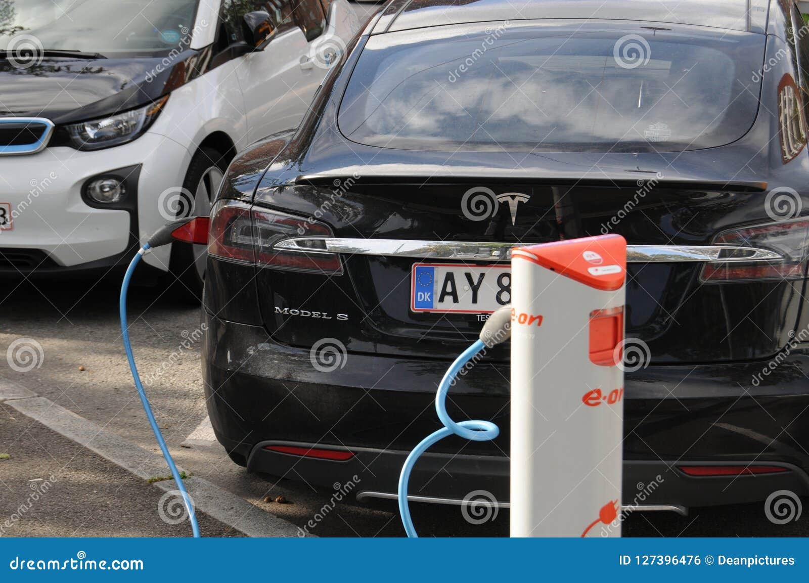 Usa Tesla Electric Car And German Bmw Electric Car Editorial Photo