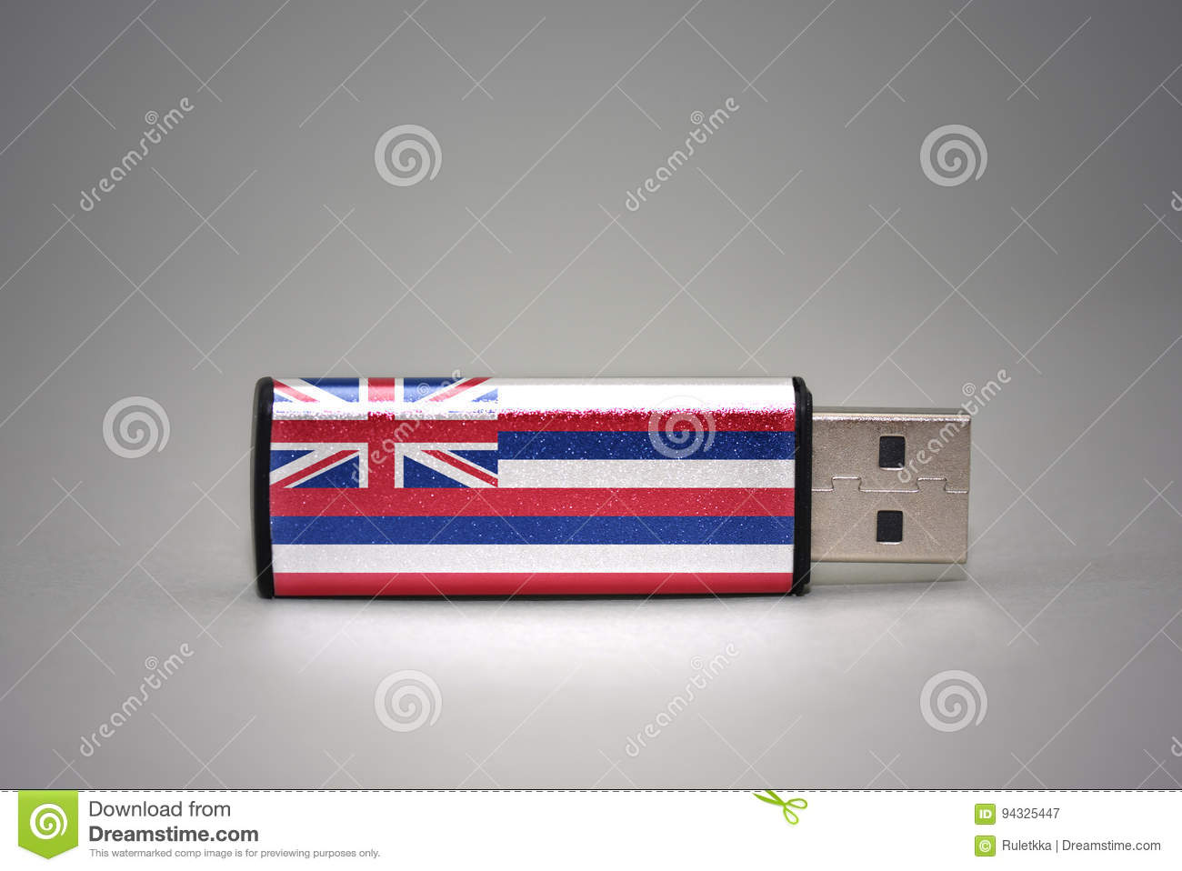 Usb flash drive with the hawaii state flag on gray background.