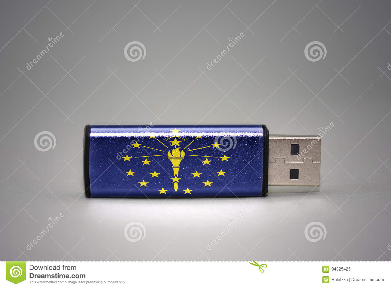 Usb flash drive with the indiana state flag on gray background.