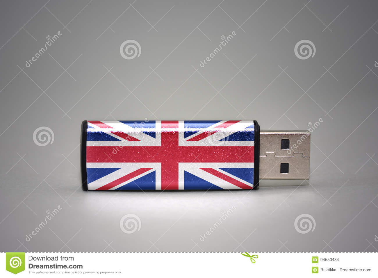 Usb flash drive with the national flag of great britain on gray background.