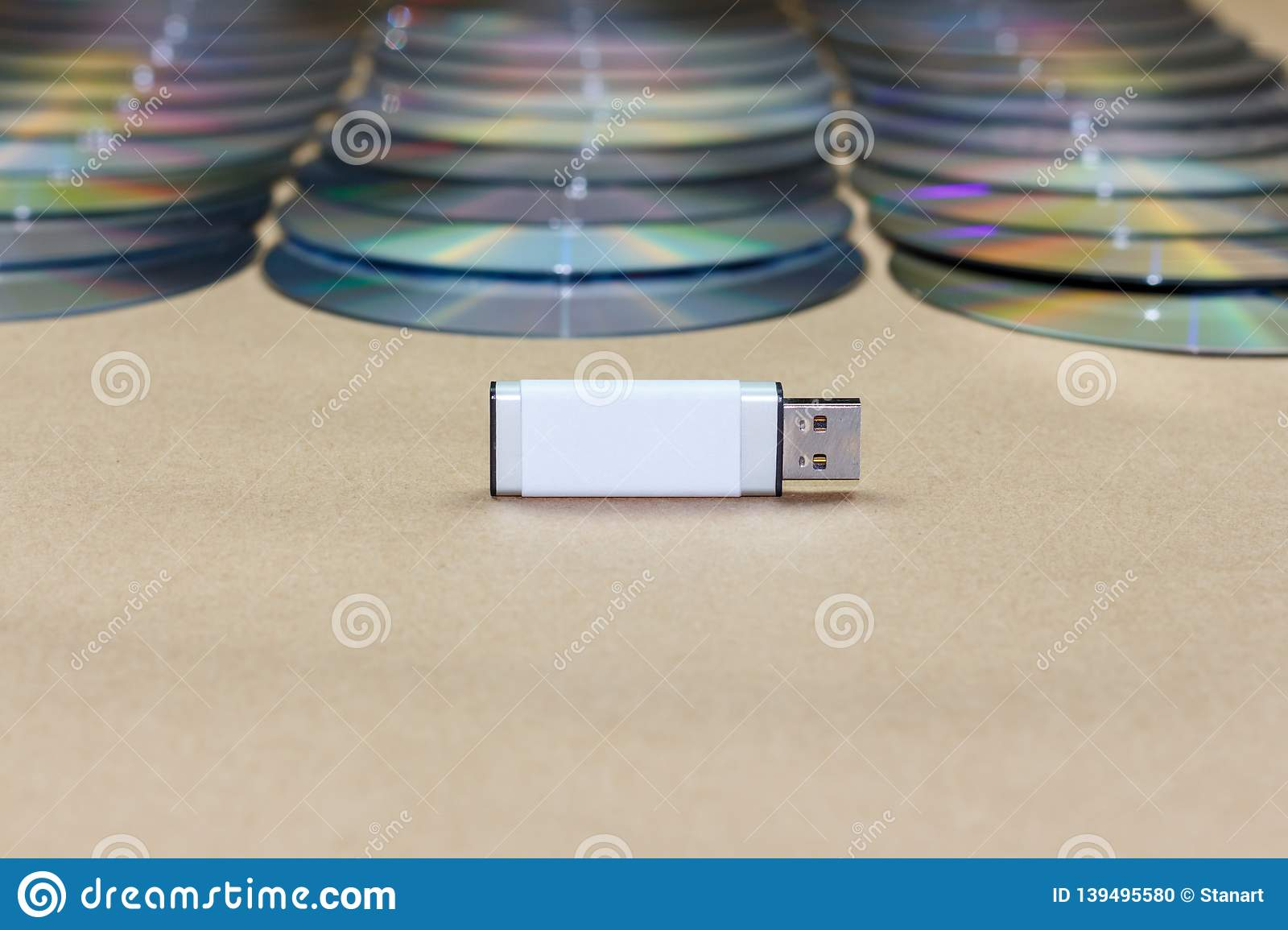 USB Universal Serial Bus Stick In Front On A Stack Of Cd Compact