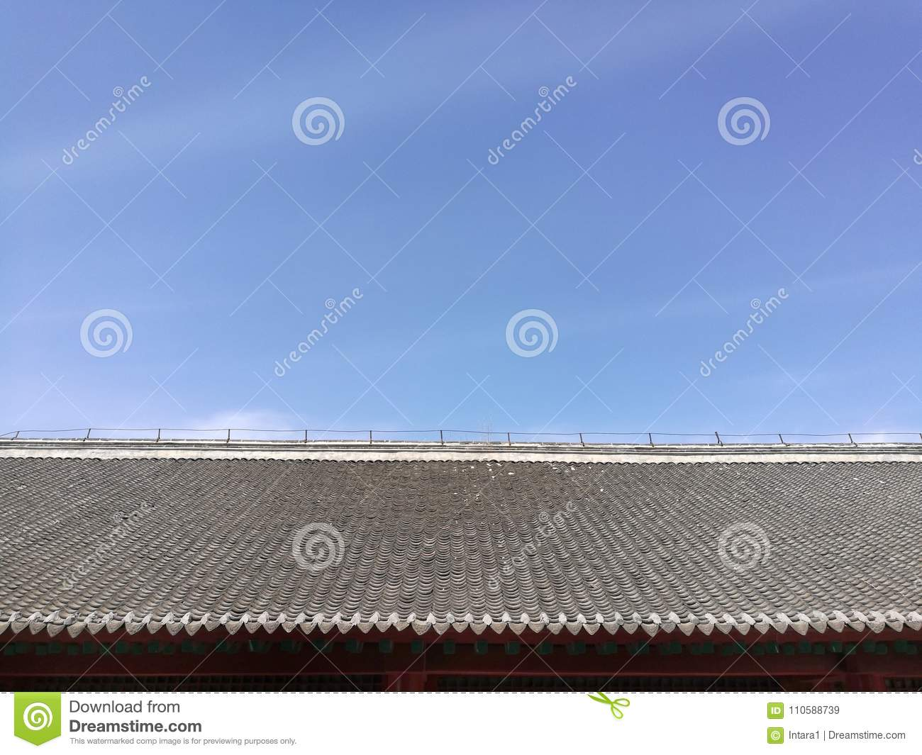 Chinese traditional tiled roof and blue sky with top copy-space; taken in Shenyang, Liaoning province, China.