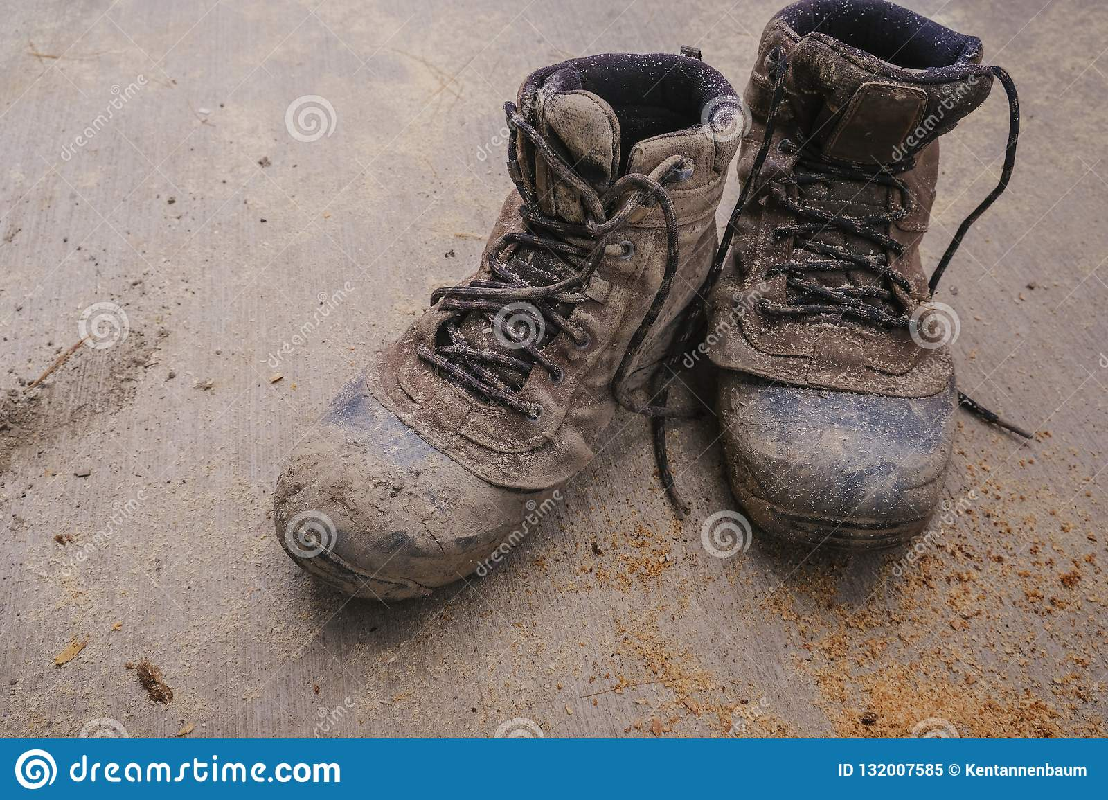 Used men`s work boots outdoors