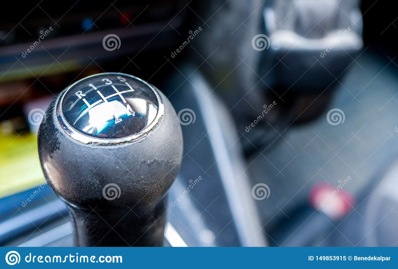 Used, worned gear shift knob close up