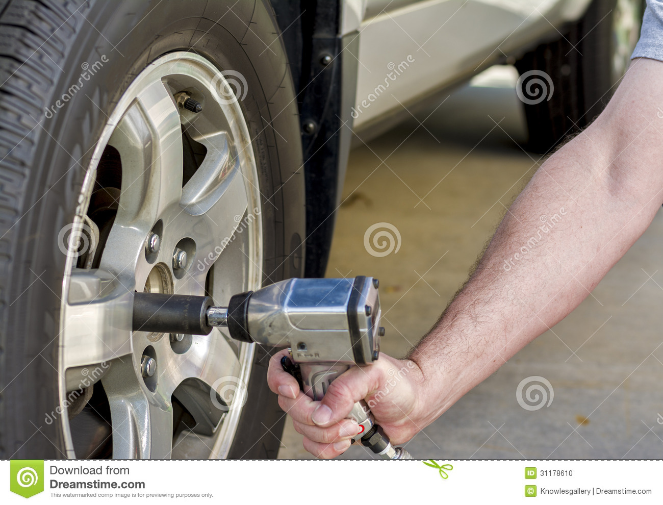 using air wrench to remove car tire stock photo image of wheel hand 31178610. Black Bedroom Furniture Sets. Home Design Ideas