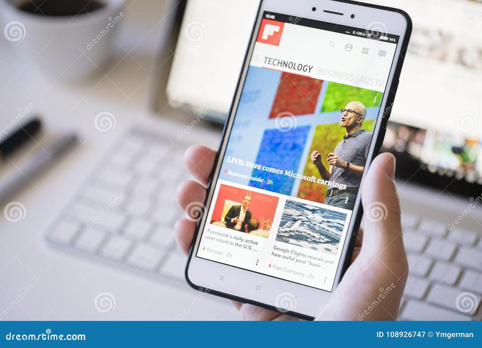 Using the Flipboard app on a smartphone