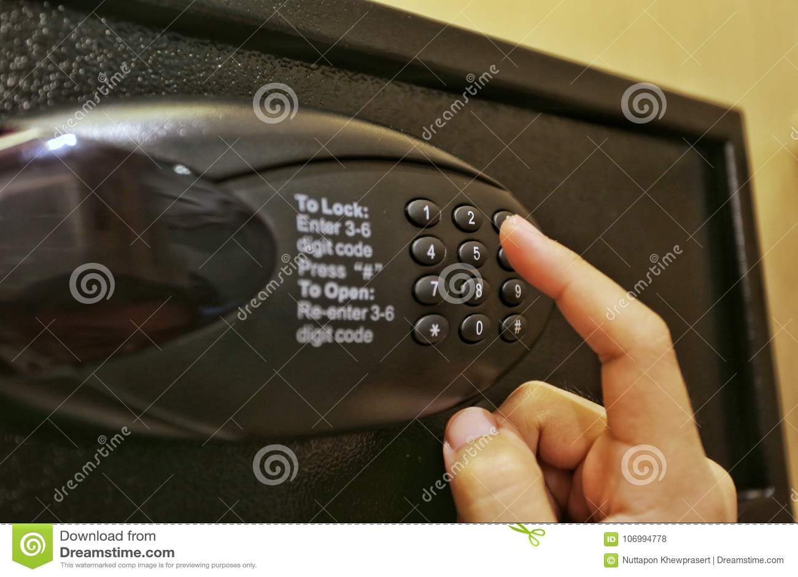 Using Forefinger / Index Finger Pushing Number Button On Black Safe