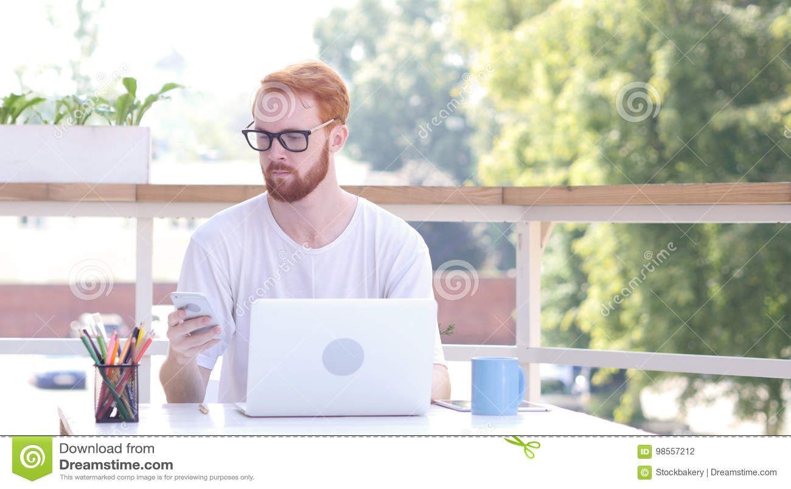 Using Smartphone, Sitting in utdoor Office, Red Hairs