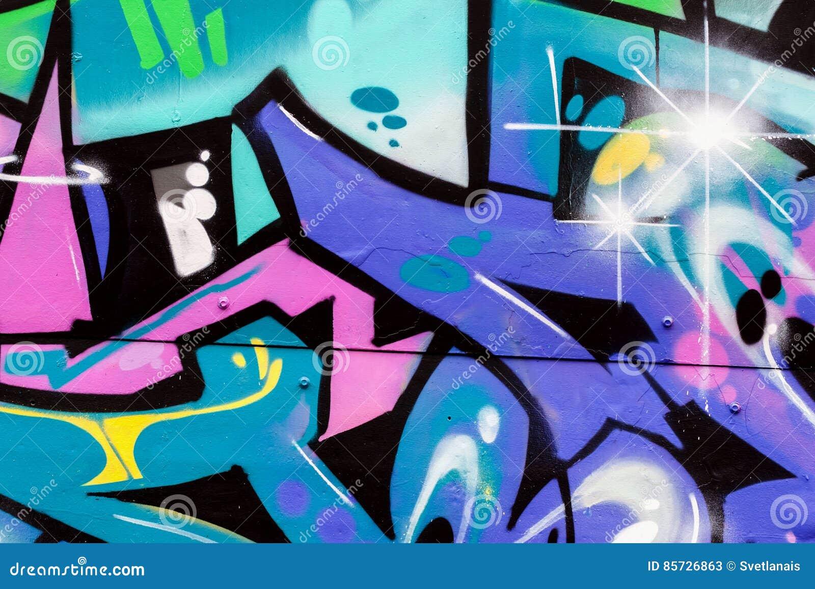 Utformar färgrika grafitti för abstrakt härlig gatakonst closeupen Detalj av en vägg Kan vara användbart för bakgrunder moder