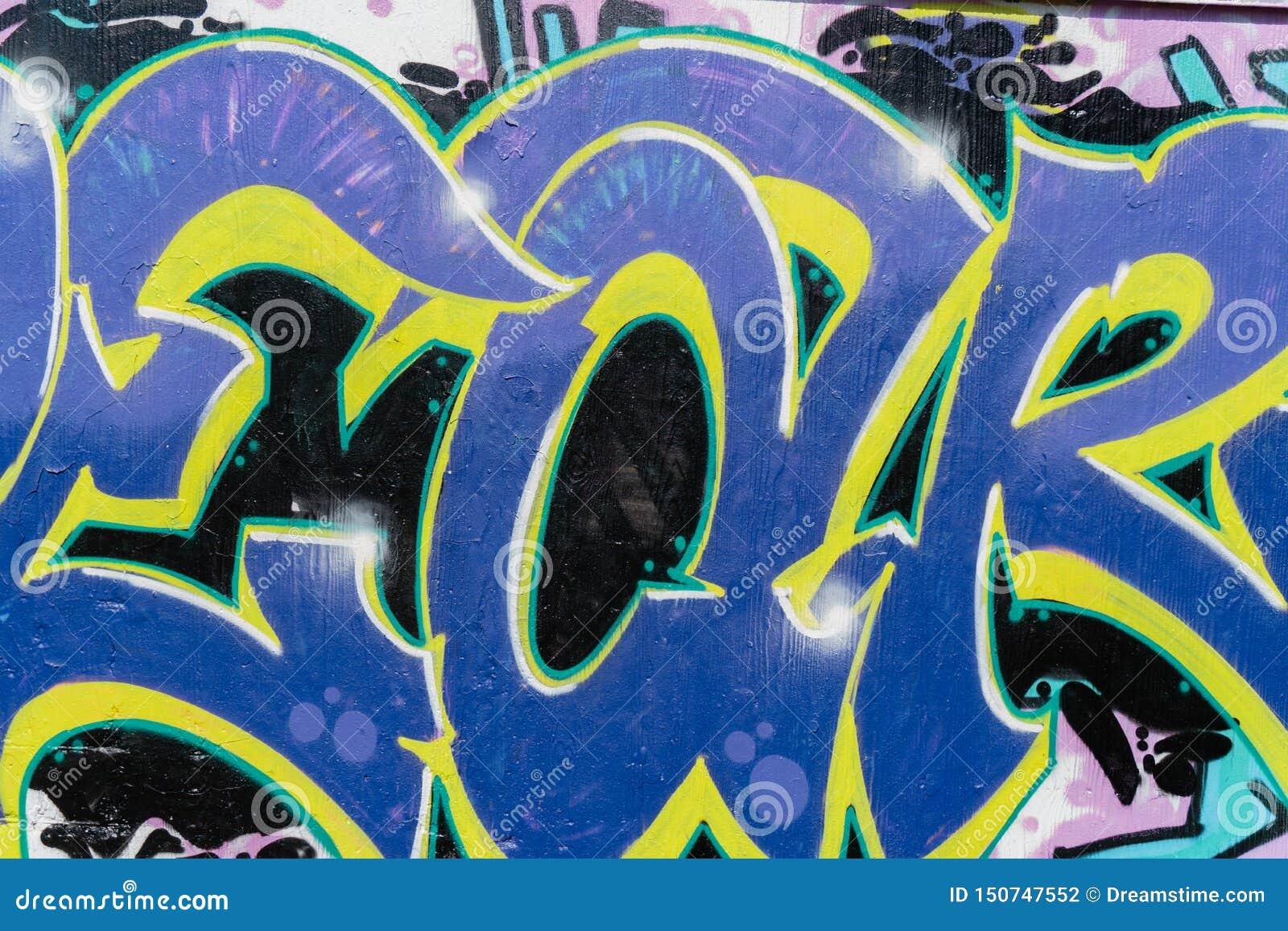 Utformar f?rgrika grafitti f?r abstrakt h?rlig gatakonst closeupen Detalj av en v?gg Kan vara anv?ndbart f?r bakgrunder Modernt i