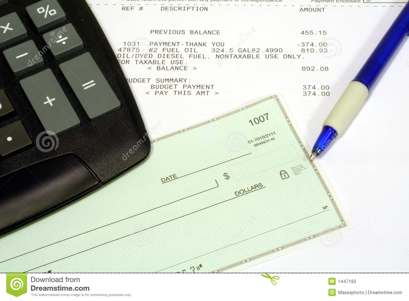 utility bill  personal check and calculator stock photos