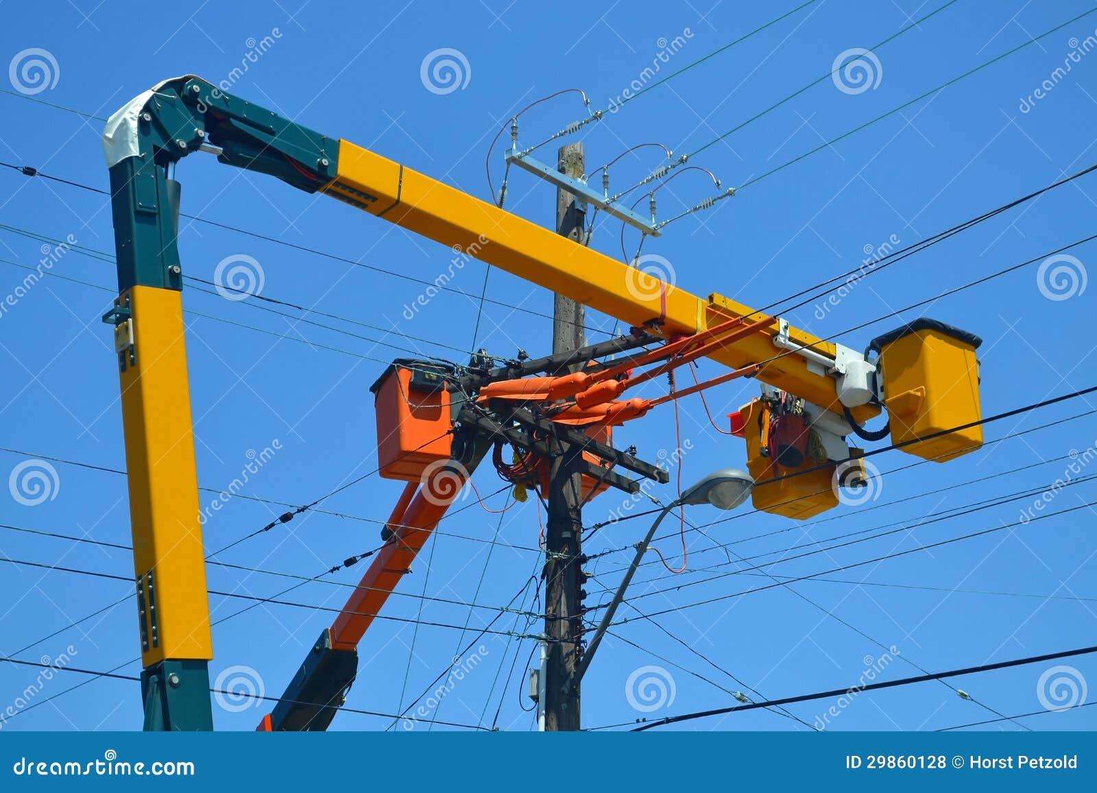 lift trucks on power lines  royalty free stock photos