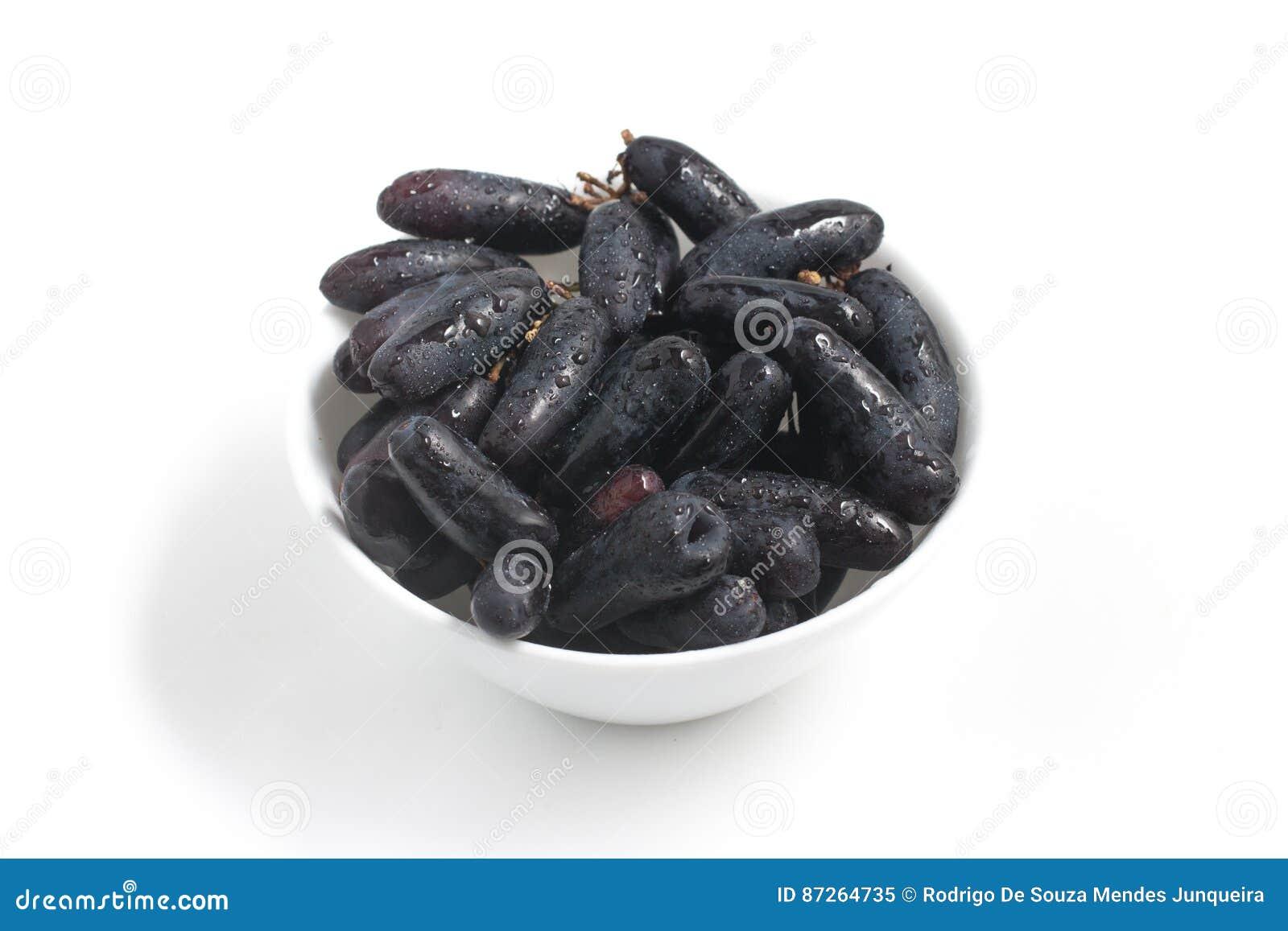 Uvas pretas longas da meia-noite