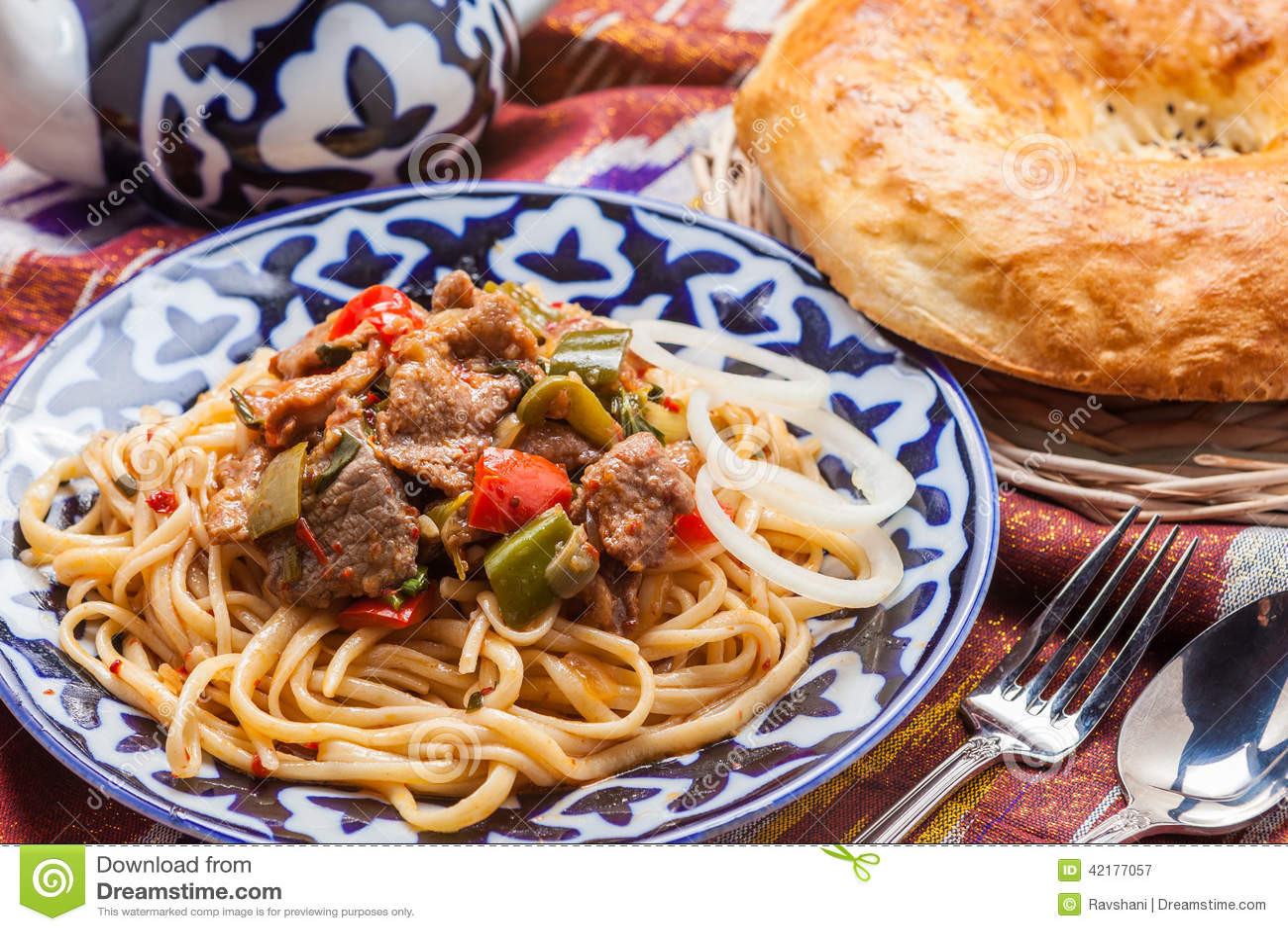 Uzbek national food lagman on traditional fabric adras for Atlas house uzbek cuisine