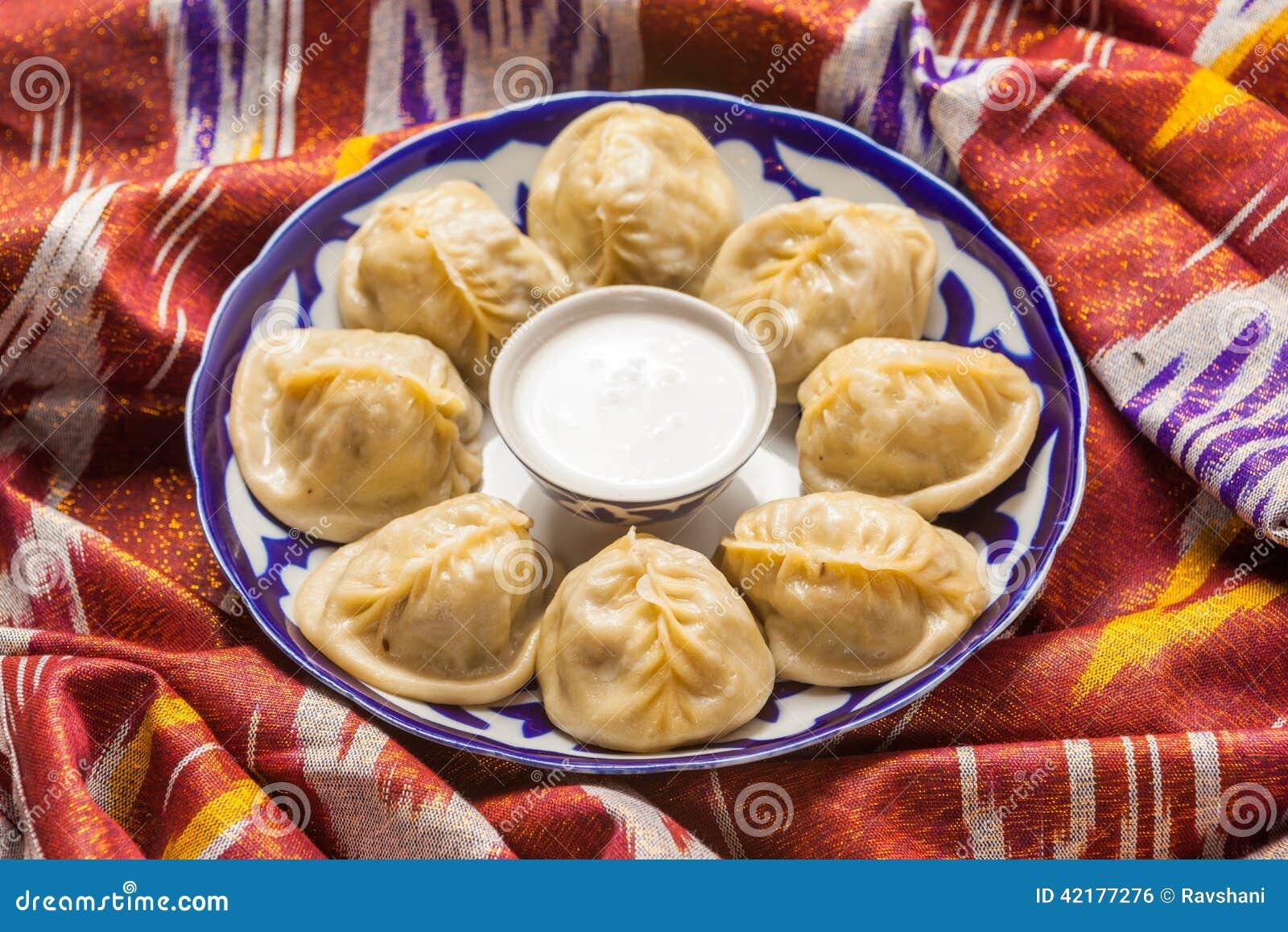 Uzbek National Food Manti On Traditional Fabric Adras Stock Photo
