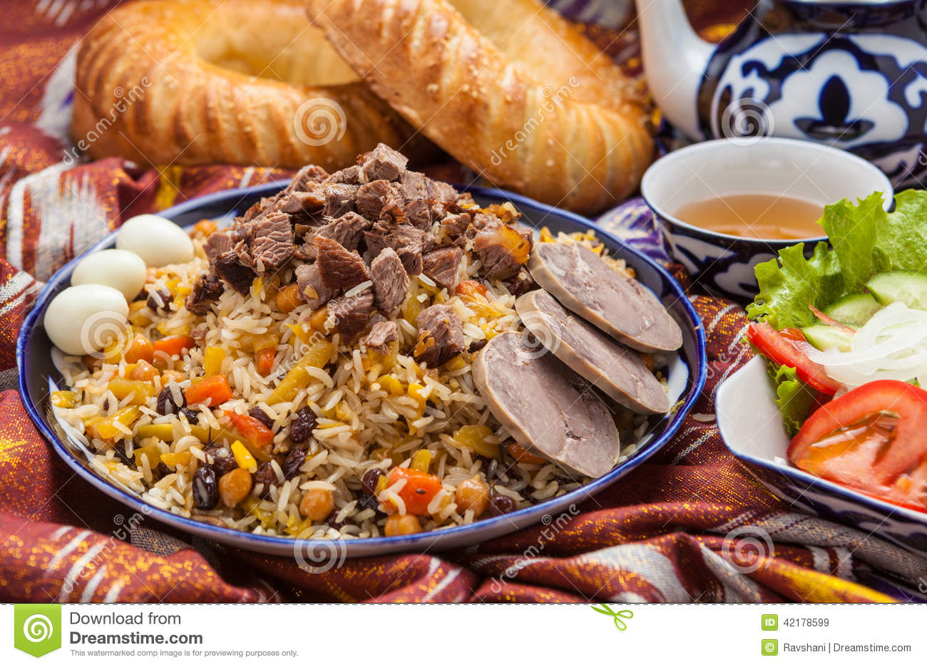 uzbek national food pilaf on traditional fabric adras stock image  uzbek national food pilaf on traditional fabric adras