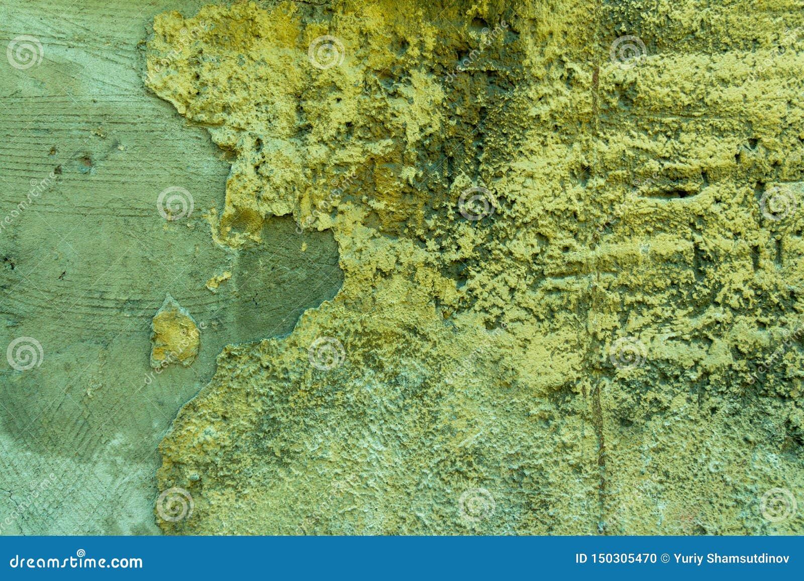 Vägg av betong och tegelsten med murbruktextur