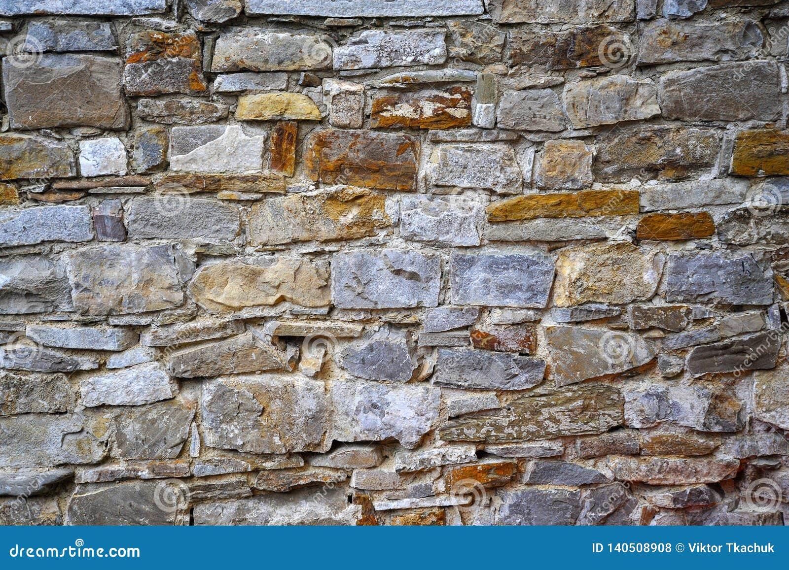 Vägg för sten- eller sandstenbakgrund