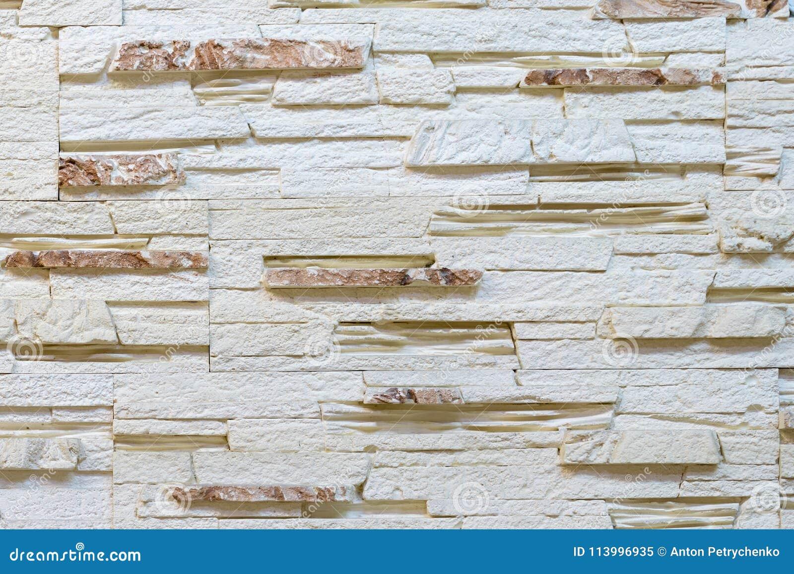 Vägg som göras av dekorativt ljus - brun sten Dekorera för spisen Bakgrund