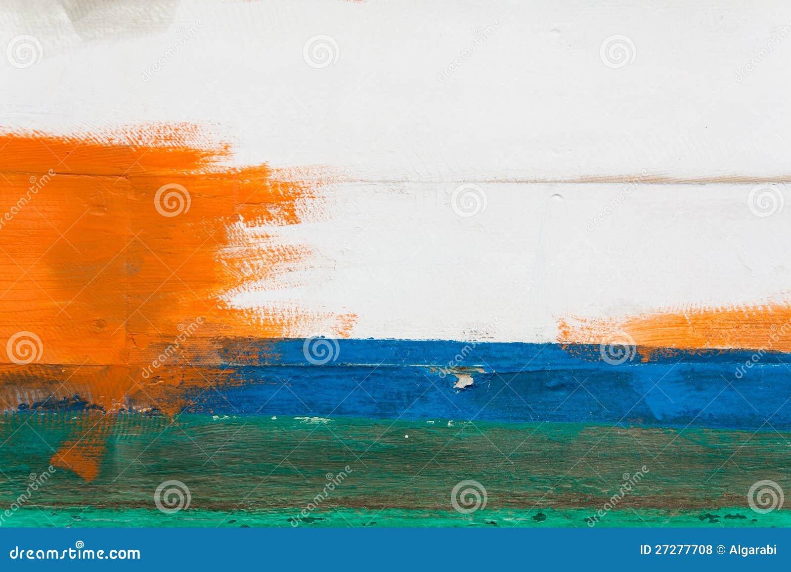 Vägg som målas i vitt, blått, grönt och orange