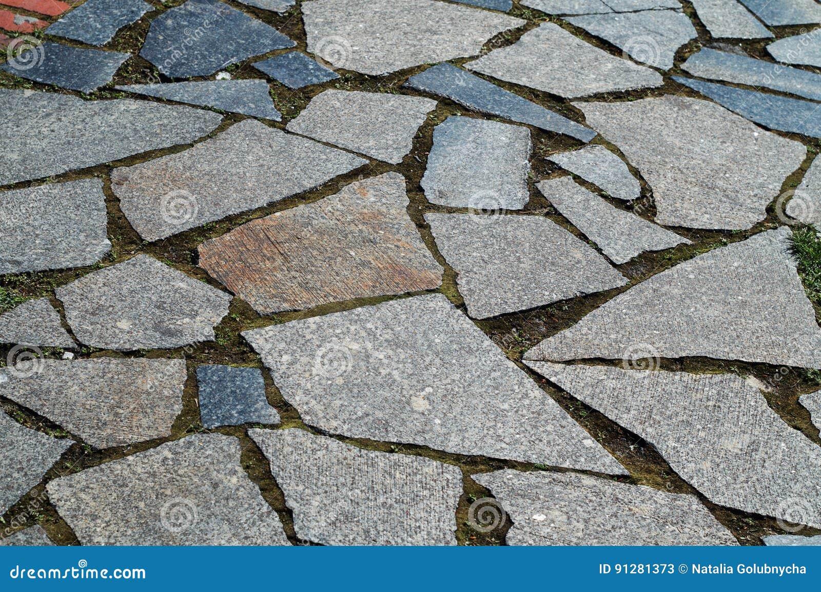 Vägyttersida som göras av granittegelplattor