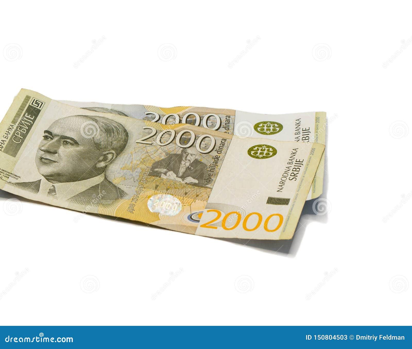 Värde för två sedlar 2000 serbiska dinar med en stående av en klimatforskare Milutin Milankovic isolerade på en vit bakgrund